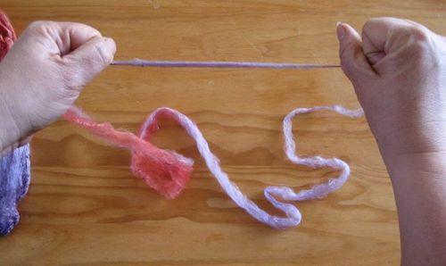 Opening hankie becoming yarn